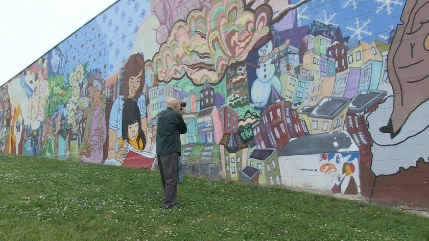 Lou photographing mural